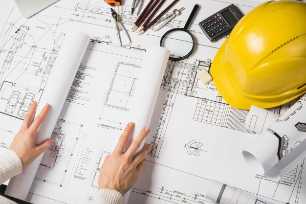 crop-architect-opening-blueprint_23-2147710985